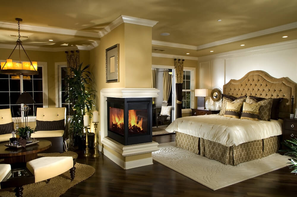 Luxury master bedroom with fireplace and sitting room