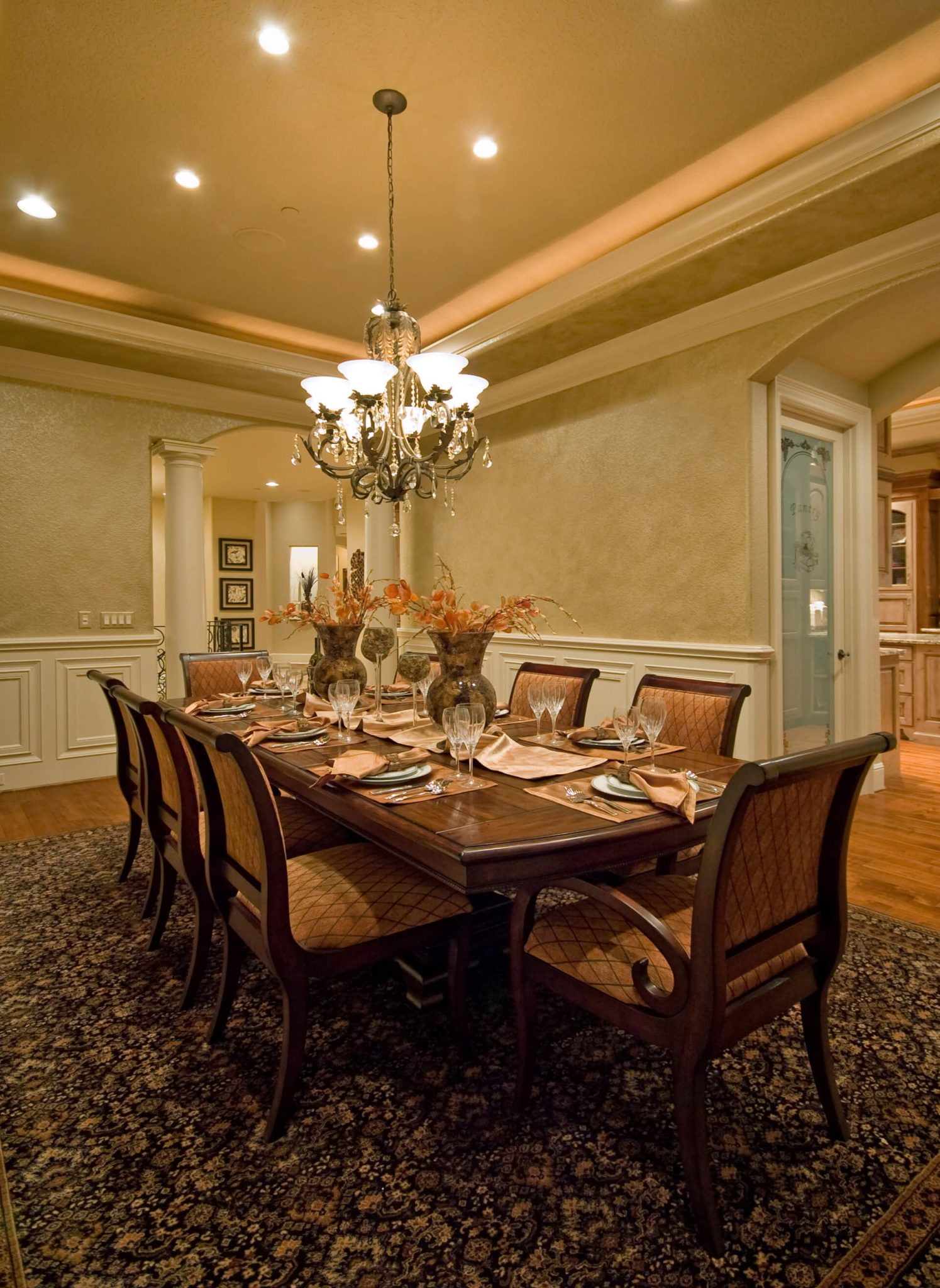 Large dining room with column framed doorways wood for Large dining room wall