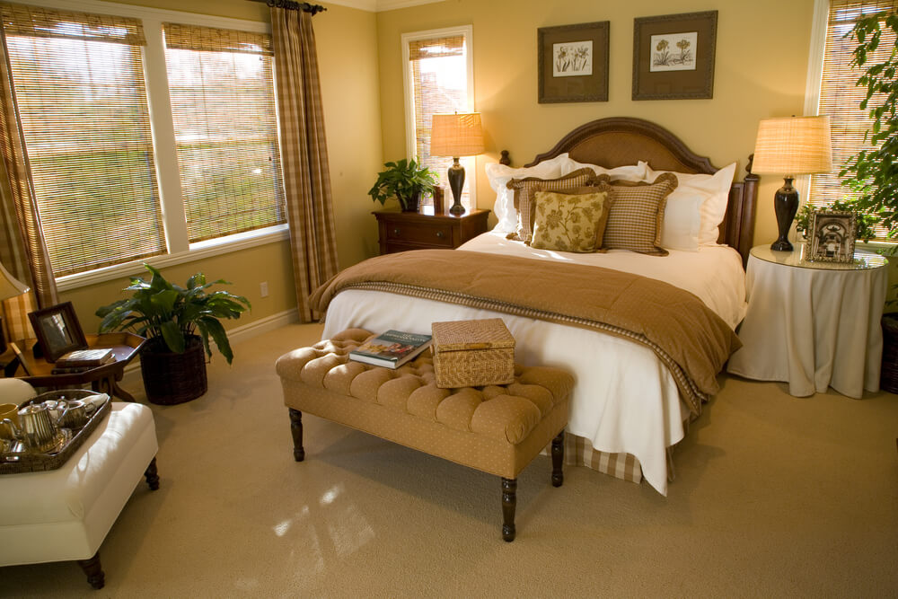 Soft brown yellow and white make up the color scheme of for Custom bedroom designs