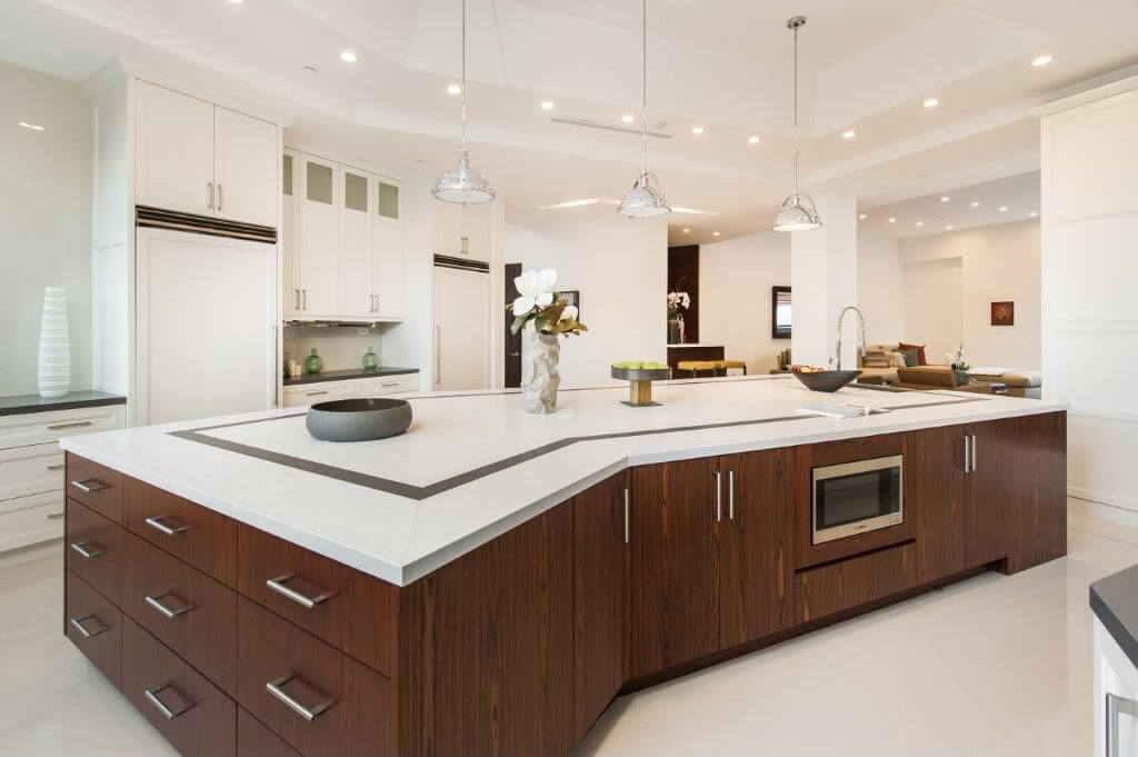 This kitchen is a great example of the contrast between natural materials like the wood island with sharp white modern surfaces on the countertops and cabinetry, over glossy white flooring.