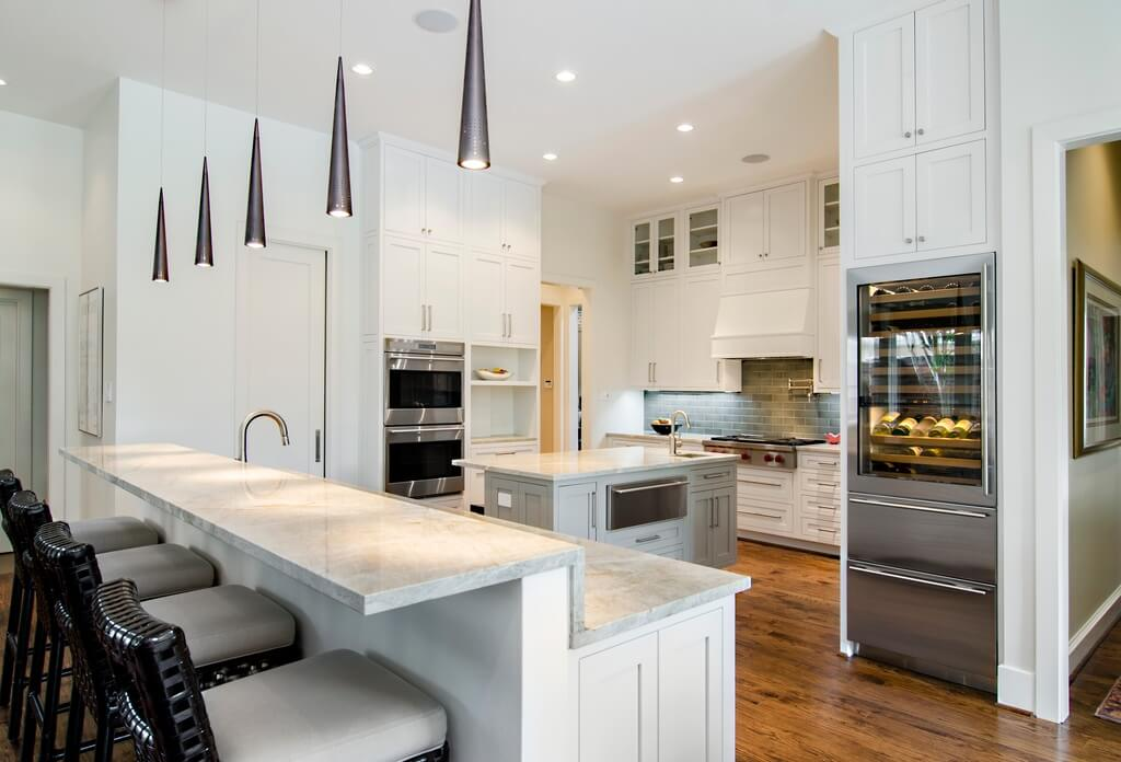 White kitchen with very tall cabinets (floor-to-ceiling).  The amount of storage in the space is incredible.  Kitchen includes wine storage.