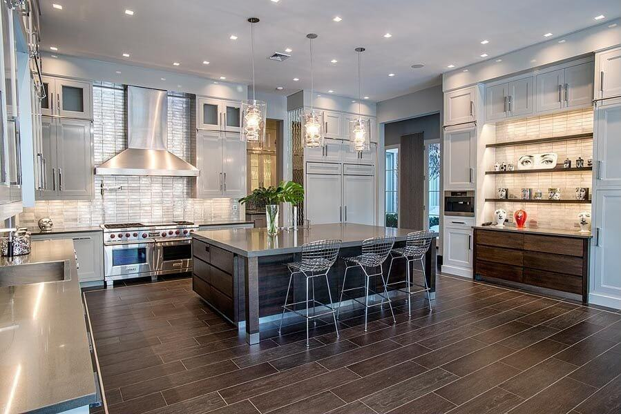 Contemporary kitchen design in light grey and dark brown and plenty of stainless steel (countertops and appliances).