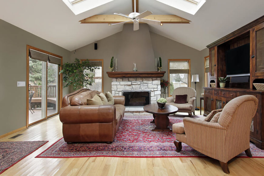 A slight arched vault in this living room is coupled with skylights and a few exposed beams to give height and natural light to this otherwise slightly dark living room.