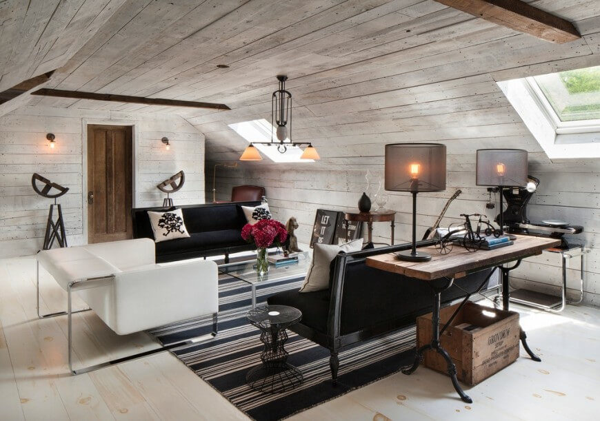 Sometimes bare walls look great, and in this case, the shiplap ceilings and walls really make this attic living room look unique.