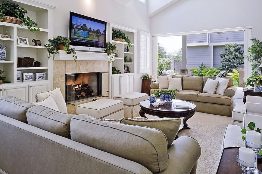 This living room is filled with seating, so a wealth of storage was built into the walls on either side of the elegant screened fireplace.