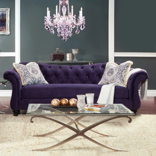 If painting the walls a bold color isn't for you, but you still want a splash of color, try choosing a sofa in a bold accent color, like this button tufted sofa with curved arms in a rich royal purple.