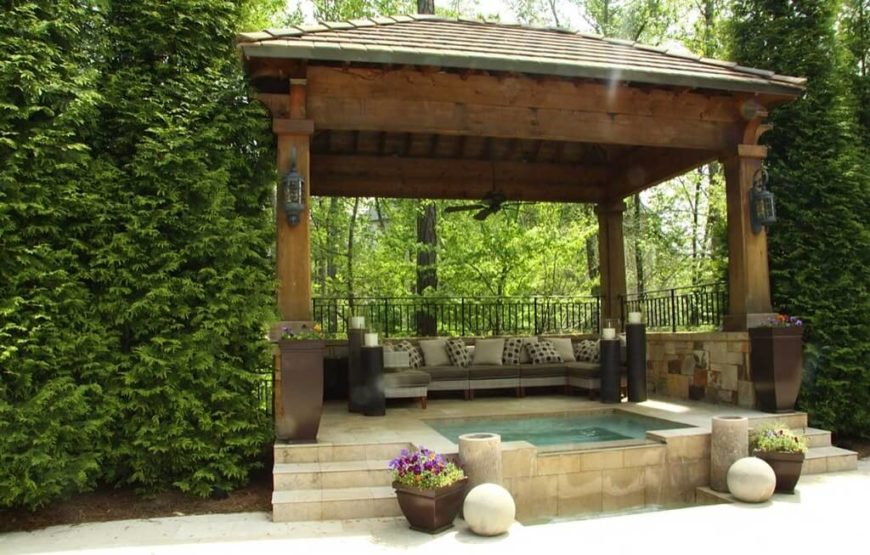 This large gazebo features an extra-deep platform that contains both a spacious hot tub and sectional seating, in addition to mood lighting.