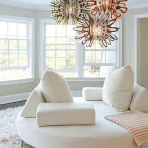 Round room with circular white sofa in beach house