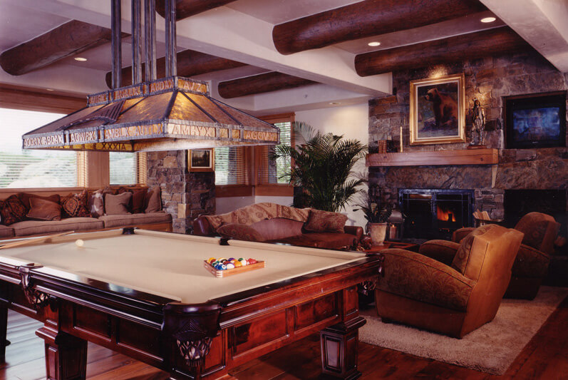 The entertainment and game room with fireplace.