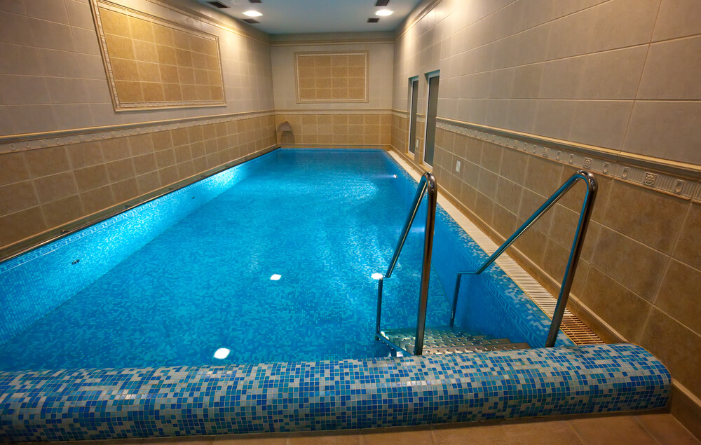 Clearly not an indoor pool designed for sitting poolside. This room is all pool - walk in and you're swimming. Perfect for the serious swimmer.