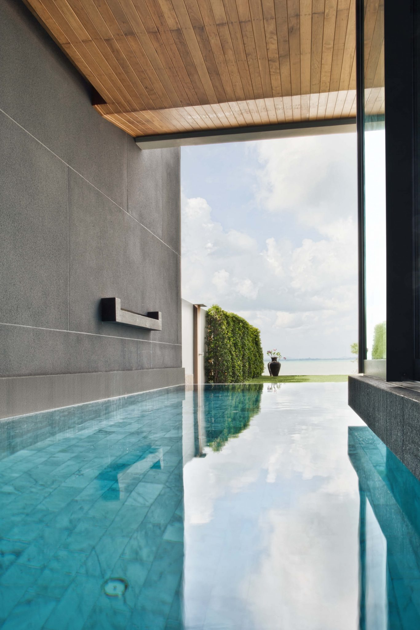 Indoor pool that feels like you're outside with the floor-to-ceiling window on exterior wall. Pool butts up to the glass window.