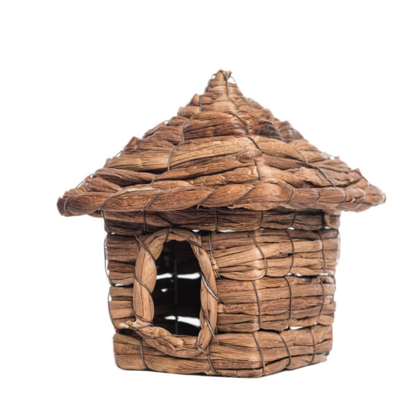 Bird house created with dried vines shaped and held together with a wire frame.