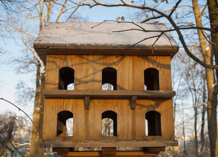 Large barn-style bird house with 12 access holes on two levels.