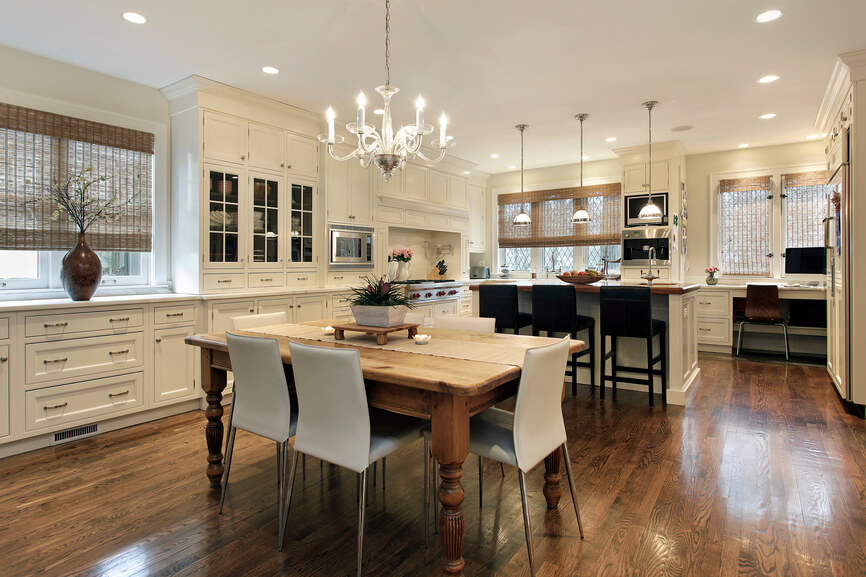 Kitchen with dining table in the center