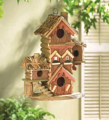 Gingerbread style bird house made with wood. Very intricate in detail.