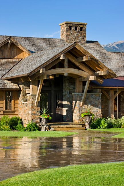 "Front entrance with large exposed beam arches in front of circular driveway. Builder: Schlauch Bottcher Construction Interior Design: <a href=""https://www.locatiarchitects.com/"">Locati Interiors</a> Photography: <a href=""https://www.rogerwadestudio.com/"">© Roger Wade Studio</a>"