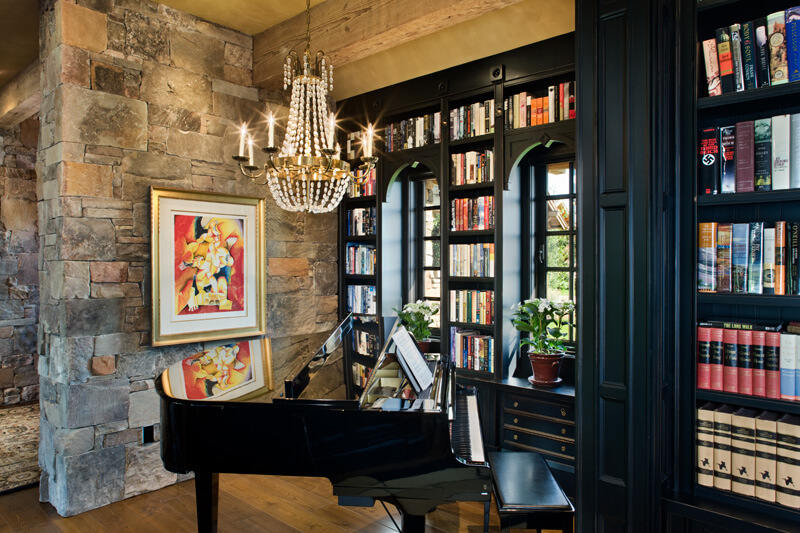 "In-home library featuring black shelving and baby grand piano. Builder: Schlauch Bottcher Construction Interior Design: <a href=""https://www.locatiarchitects.com/"">Locati Interiors</a> Photography: <a href=""https://www.rogerwadestudio.com/"">© Roger Wade Studio</a>"