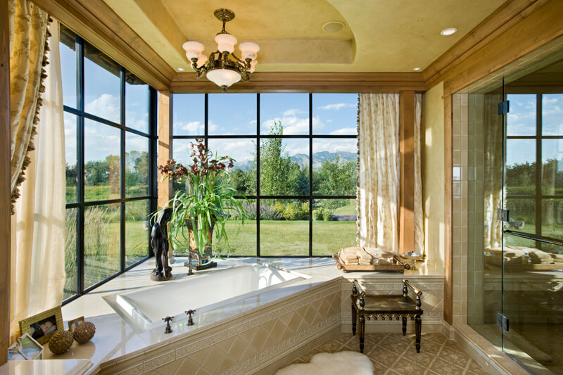 "Primary bathroom pictured here, with luxury tub and glass shower room, wide view of outdoors. Builder: Schlauch Bottcher Construction Interior Design: <a href=""https://www.locatiarchitects.com/"">Locati Interiors</a> Photography: <a href=""https://www.rogerwadestudio.com/"">© Roger Wade Studio</a>"