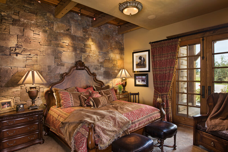 "Second bedroom with stone wall and partially hidden beams. Builder: Schlauch Bottcher Construction Interior Design: <a href=""https://www.locatiarchitects.com/"">Locati Interiors</a> Photography: <a href=""https://www.rogerwadestudio.com/"">© Roger Wade Studio</a>"