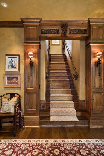 "Main staircase with filigreed entryway. Builder: Schlauch Bottcher Construction Interior Design: <a href=""https://www.locatiarchitects.com/"">Locati Interiors</a> Photography: <a href=""https://www.rogerwadestudio.com/"">© Roger Wade Studio</a>"