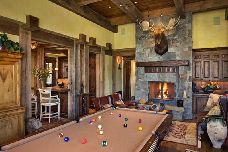 "Game room with another fireplace and traditional billiards table. Builder: Schlauch Bottcher Construction Interior Design: <a href=""https://www.locatiarchitects.com/"">Locati Interiors</a> Photography: <a href=""https://www.rogerwadestudio.com/"">© Roger Wade Studio</a>"
