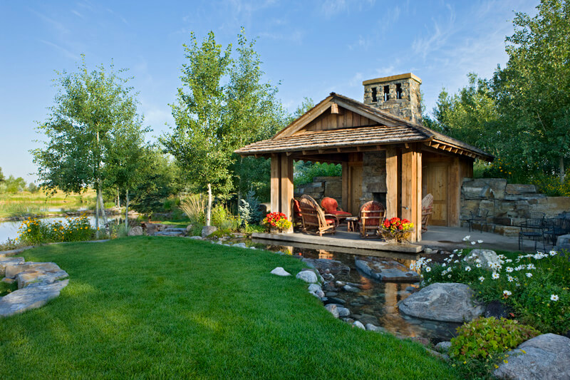 "Covered patio on opposite end of pond. Builder: Schlauch Bottcher Construction Interior Design: <a href=""https://www.locatiarchitects.com/"">Locati Interiors</a> Photography: <a href=""https://www.rogerwadestudio.com/"">© Roger Wade Studio</a>"