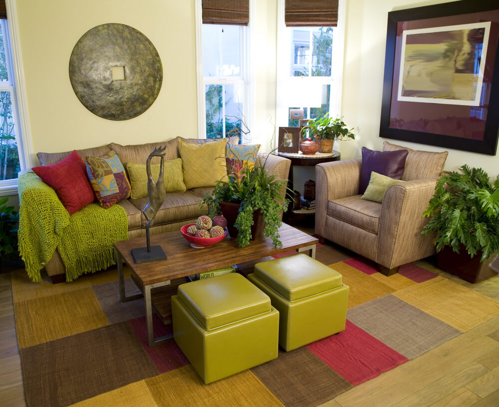 Living room design with plenty of color - various shades of brown, pink and green.