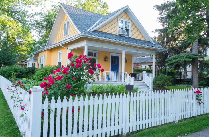Cute home with white picket fence.