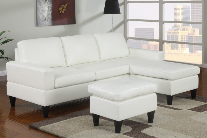 Designed for total functionality, this white faux leather sofa is as comfortable as it is practical. The reversible chaise means you can fit the sofa to your space, and the included ottoman rounds out the set.