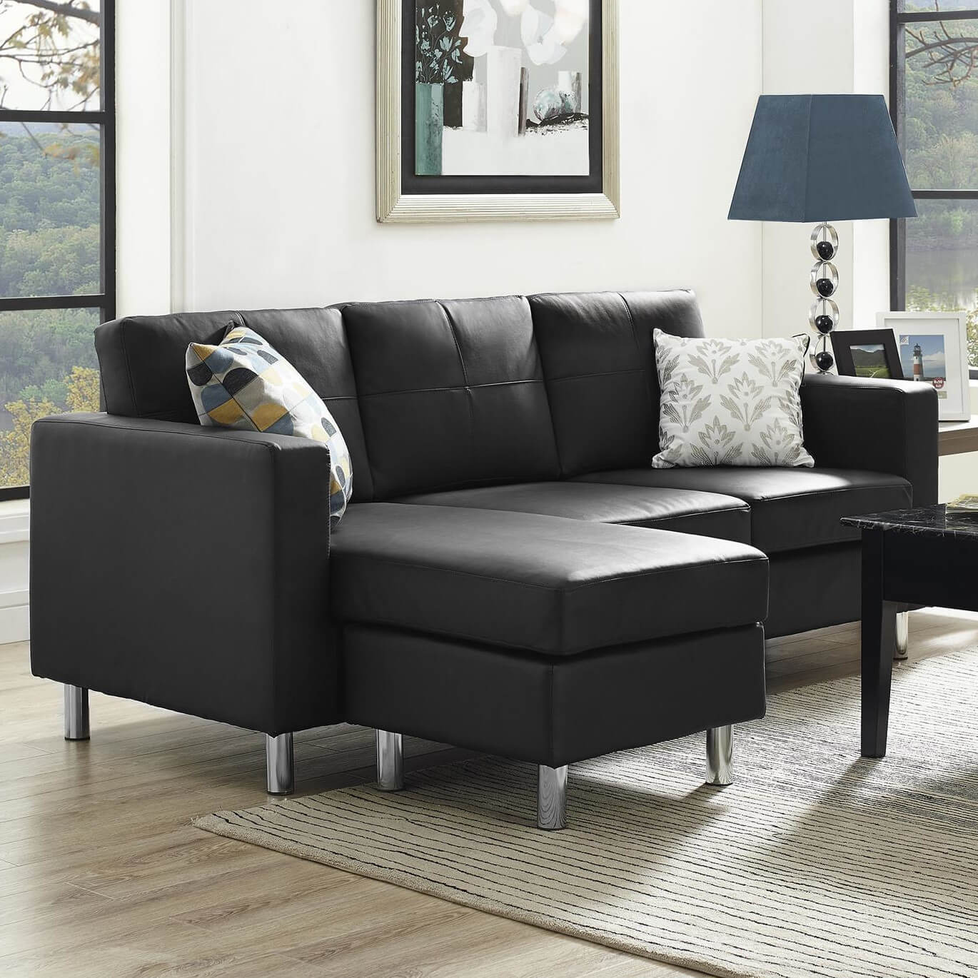 A lovely black sectional with a reversible chaise. The legs are aluminum, and the piece is upholstered in a tailored faux leather in black, but is also available in a plush microfiber.