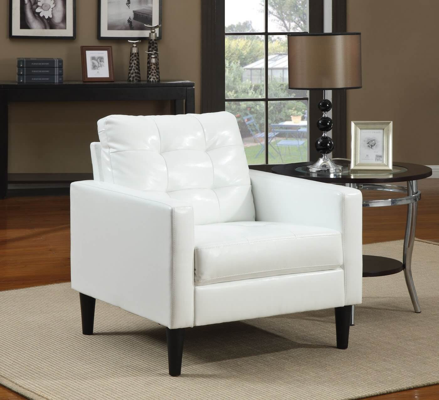 Balin collection accent chair from ACME features stuffed cushion back in polyurethane faux white leather, with foam stuffing and black wood tapered feet.