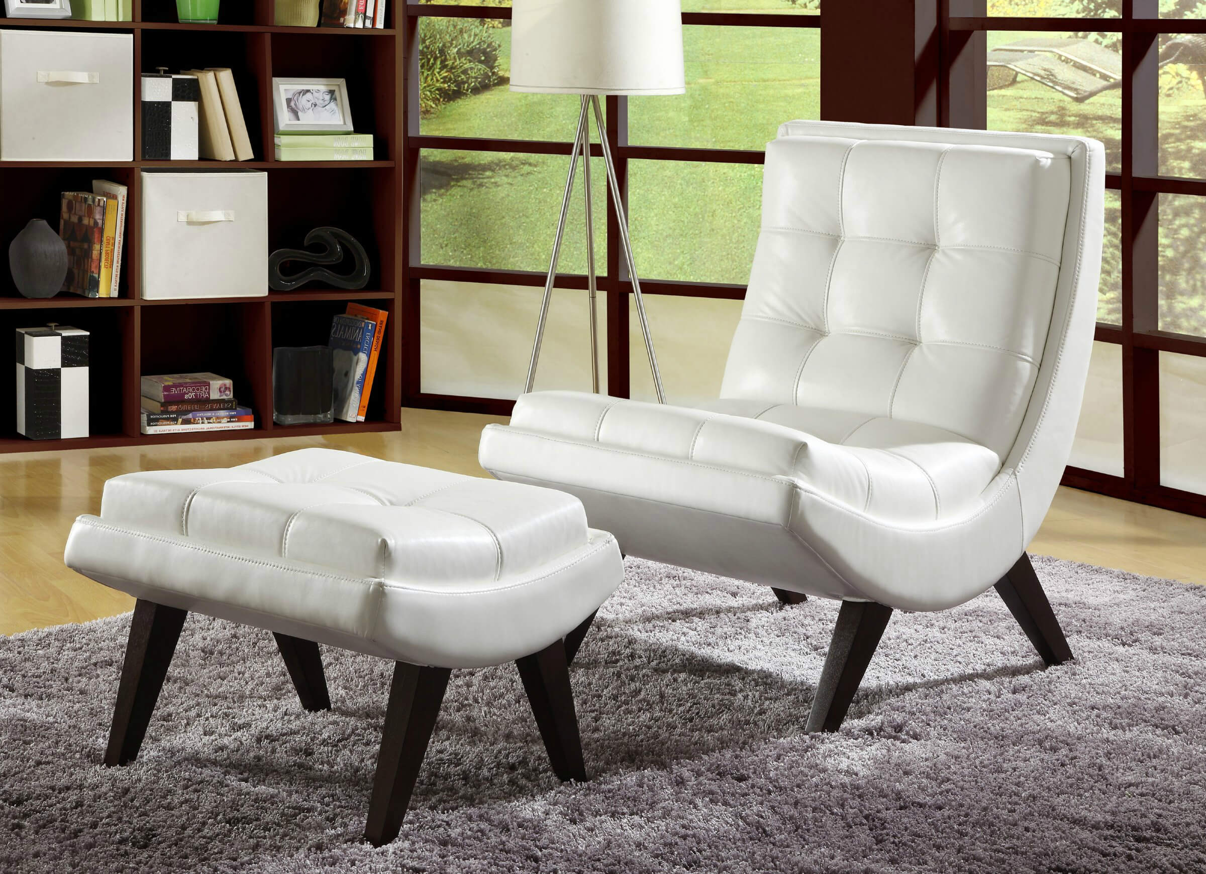 Contemporary accent chair paired with ottoman comes in white faux leather with button tufting in curved arch, modernist design. Hardwood construction and tapered dark legs keep it durable and classy.