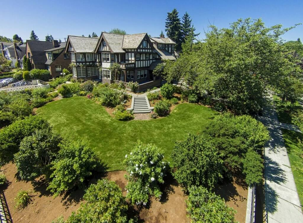 This aerial view of the home showcases the huge rolling lawn and countless angles of the classic Tudor design.