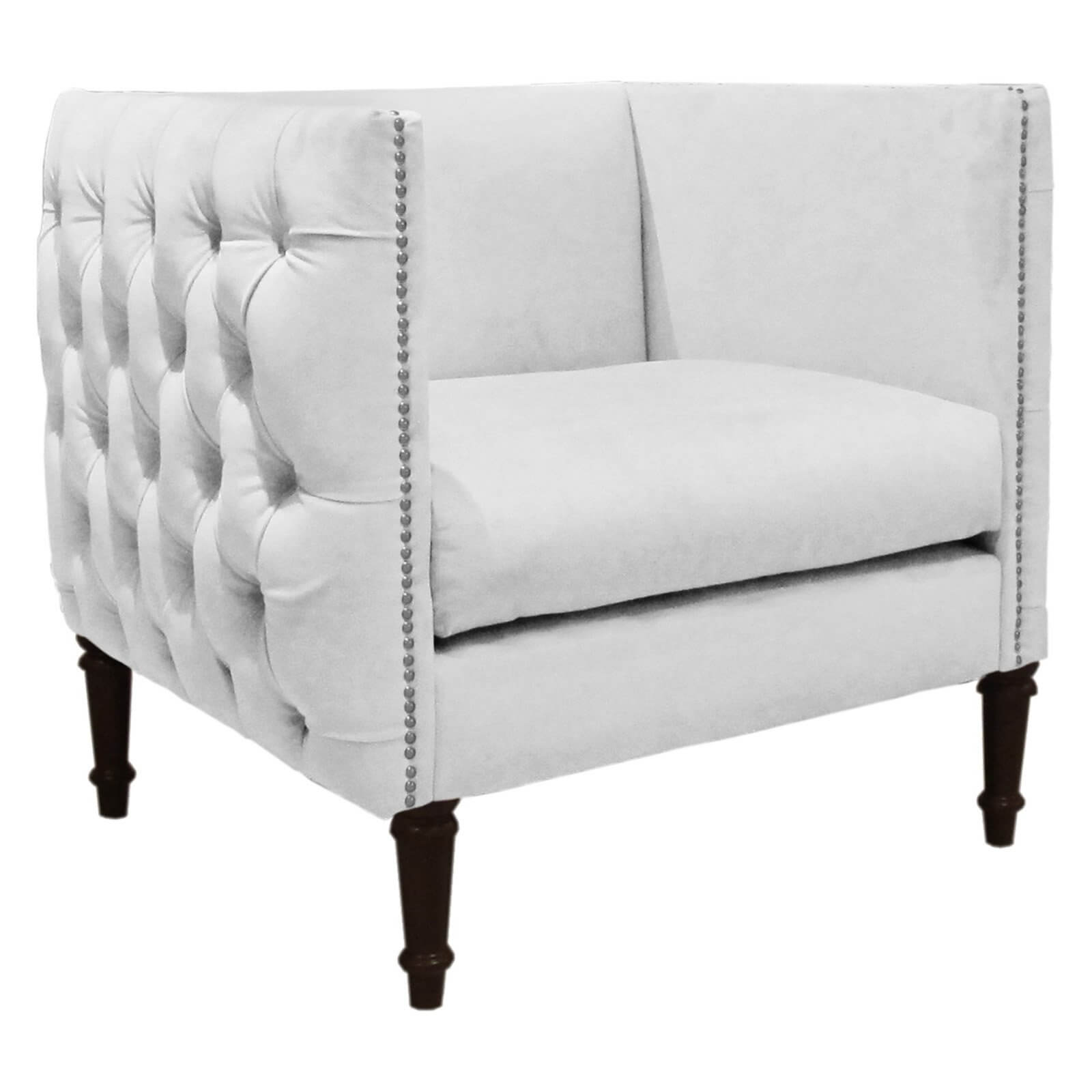 Skyline Furniture brings us this wood construction accent chair with velvet fabric upholstery featuring button tufting and nail head trim, with thick foam padding for comfort.