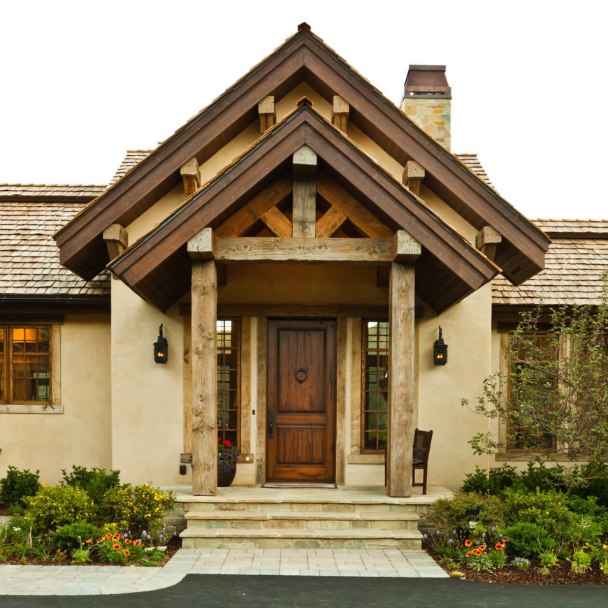 Here is a close view of the main entrance, featuring large natural wood beams. Custom made copper chimney cap can be seen above.