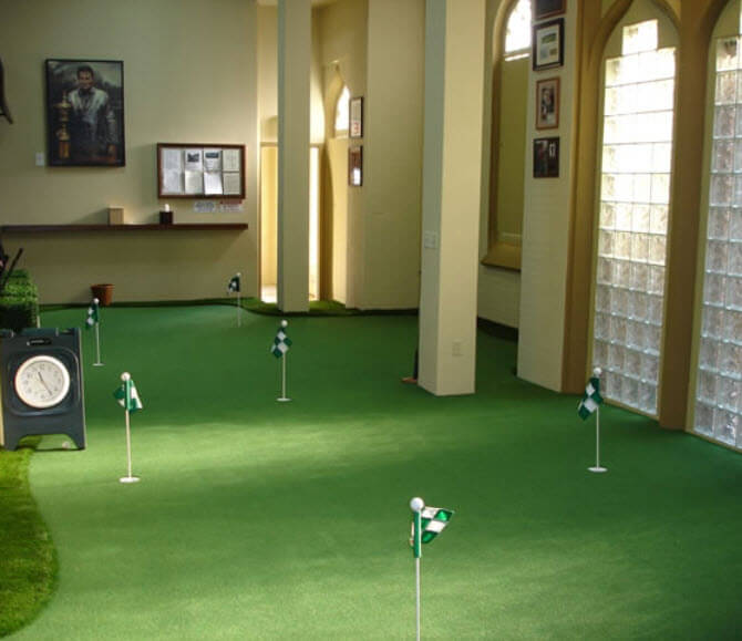 This indoor putting green incorporates an entire room, with pillars as hazards, an exterior wall defining the edge, and multiple holes and approaches.
