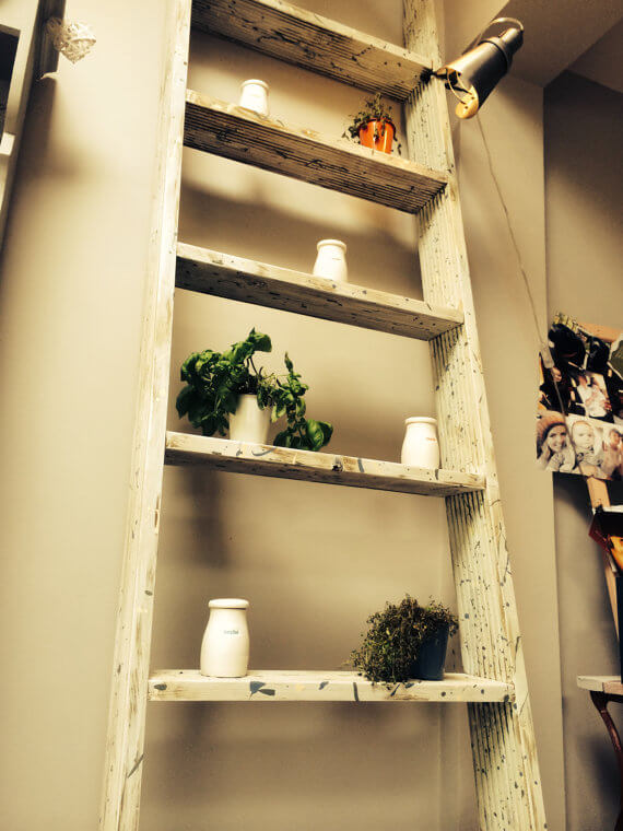 Ladder shelf with distressed paint job