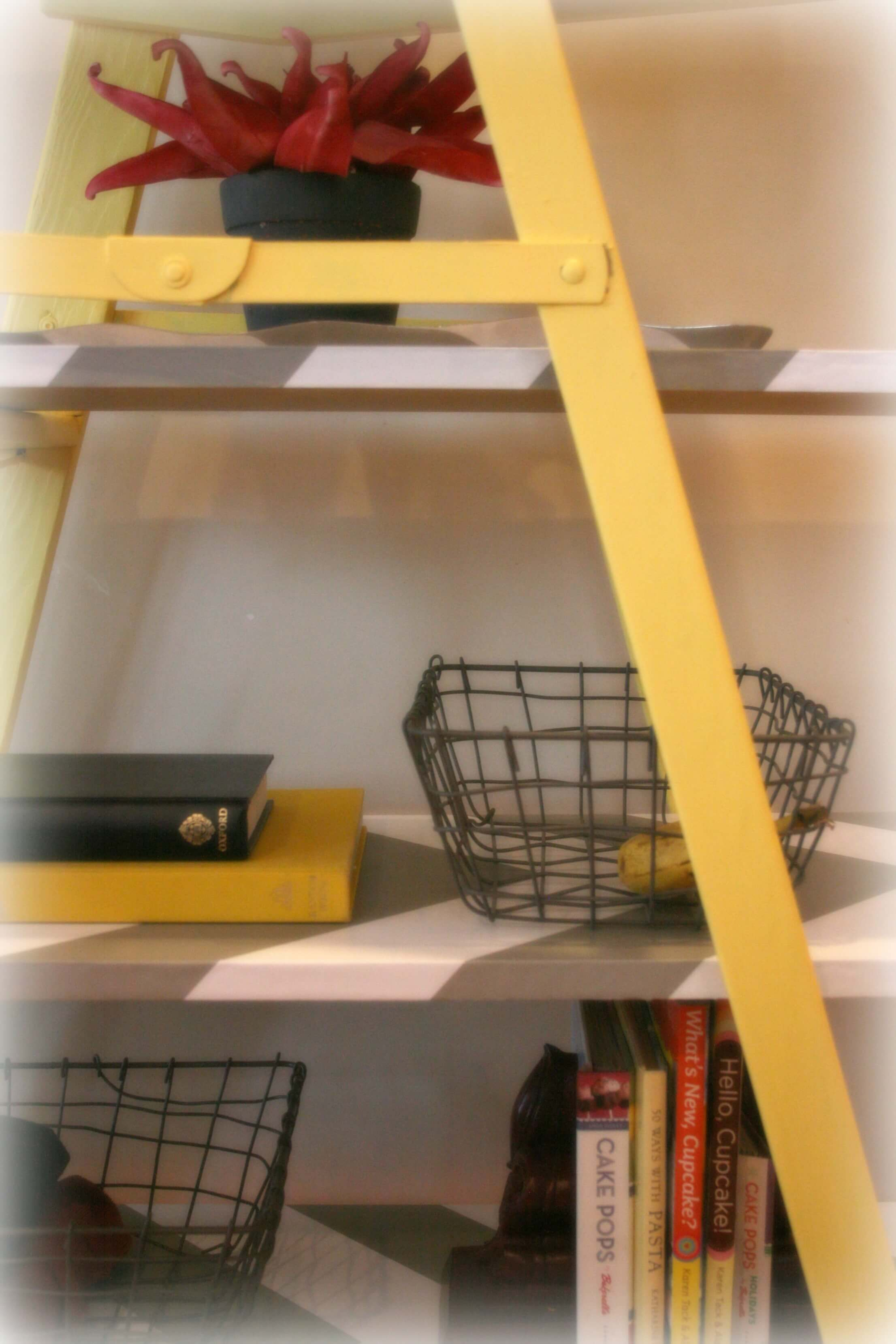 Close up view of the shelving unit storing baskets, books and decorative items