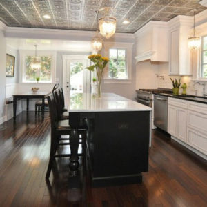 white kitchen with ceiling tiles