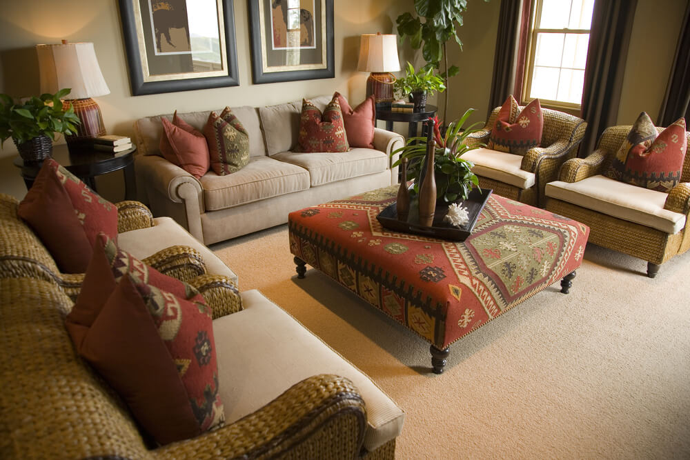 Spacious living room in earth tones and splashes of red for Living room ideas without coffee table