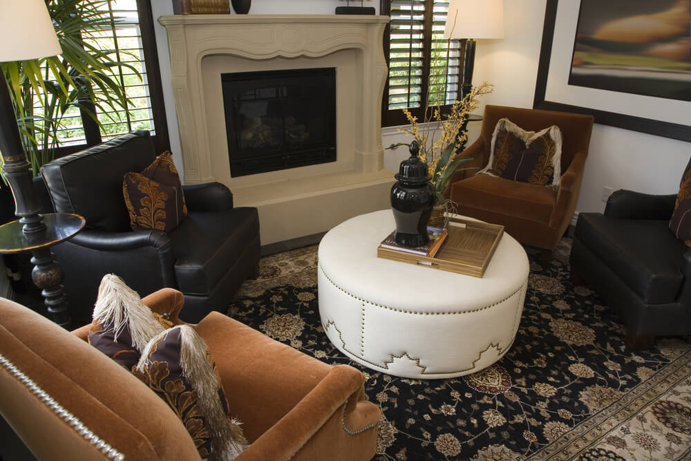 Cozy living room with commanding stone fireplace features for Portable living room furniture