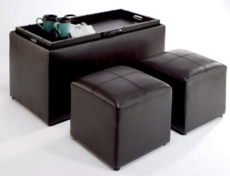 This ottoman features storage for twin smaller units inside, in addition to doubling as a coffee table with its removable lid flipping into a hardwood tray. Espresso colored faux leather provides comfort and durability, while keeping costs down.