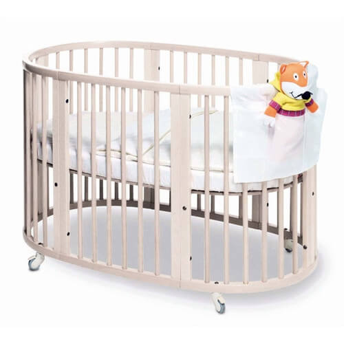 Here is the full size Sleepi crib from Stokke, designed for older babies and small children. Rounded design ensures safety and mobility, with lockable caster feet. Modular design can be converted to toddler bed, or even two chairs. Features environmentally friendly beechwood construction.