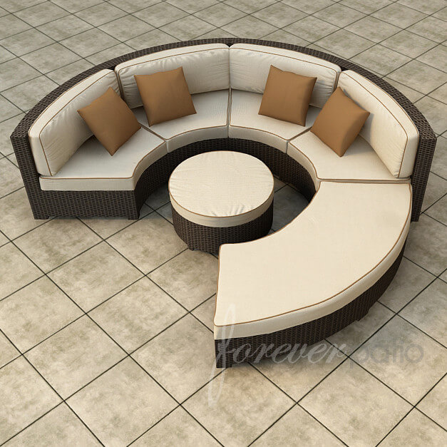 Circular, conversational patio sectional pairs brightly toned thick padded cushioning with dark resin wicker construction, with large backless section for chaise or ottoman purposes, plus circular ottoman at center.