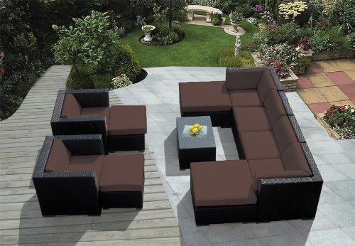 This uniquely configured patio sectional lays mocha cushioning over black wicker body, with twin large ottoman pieces allowing for chaise end-segments on the sofa, facing pair of armchairs with their own ottomans over central glass topped table.