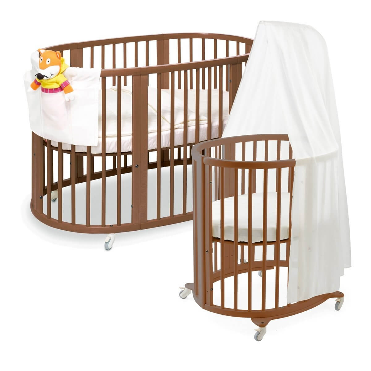 This lengthy oval crib from Stokke is designed to grow with your child. Initial circular shape can be enhanced with extra parts, extending into lengthy sleeper for larger children. Sustainable beechwood construction and soft, rounded edges make this durable and safe, while caster feet add portability.