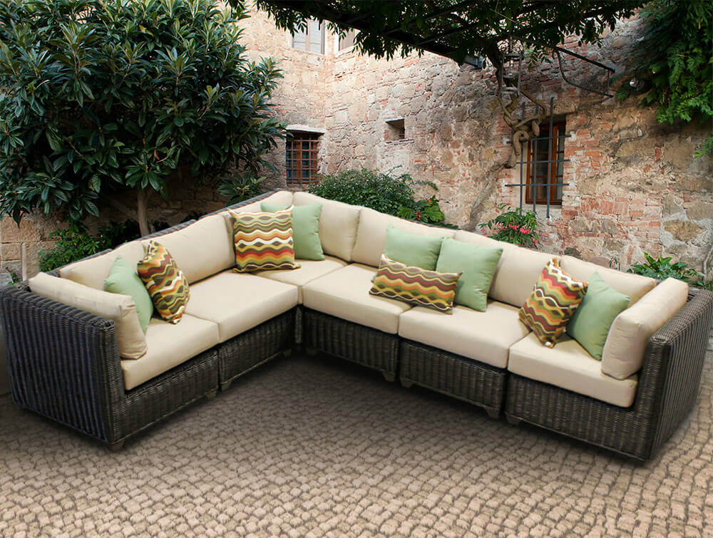 L-shaped resin wicker patio sectional in dark brown and beige cushioning features multiple cubic pieces for a variety of seating options.