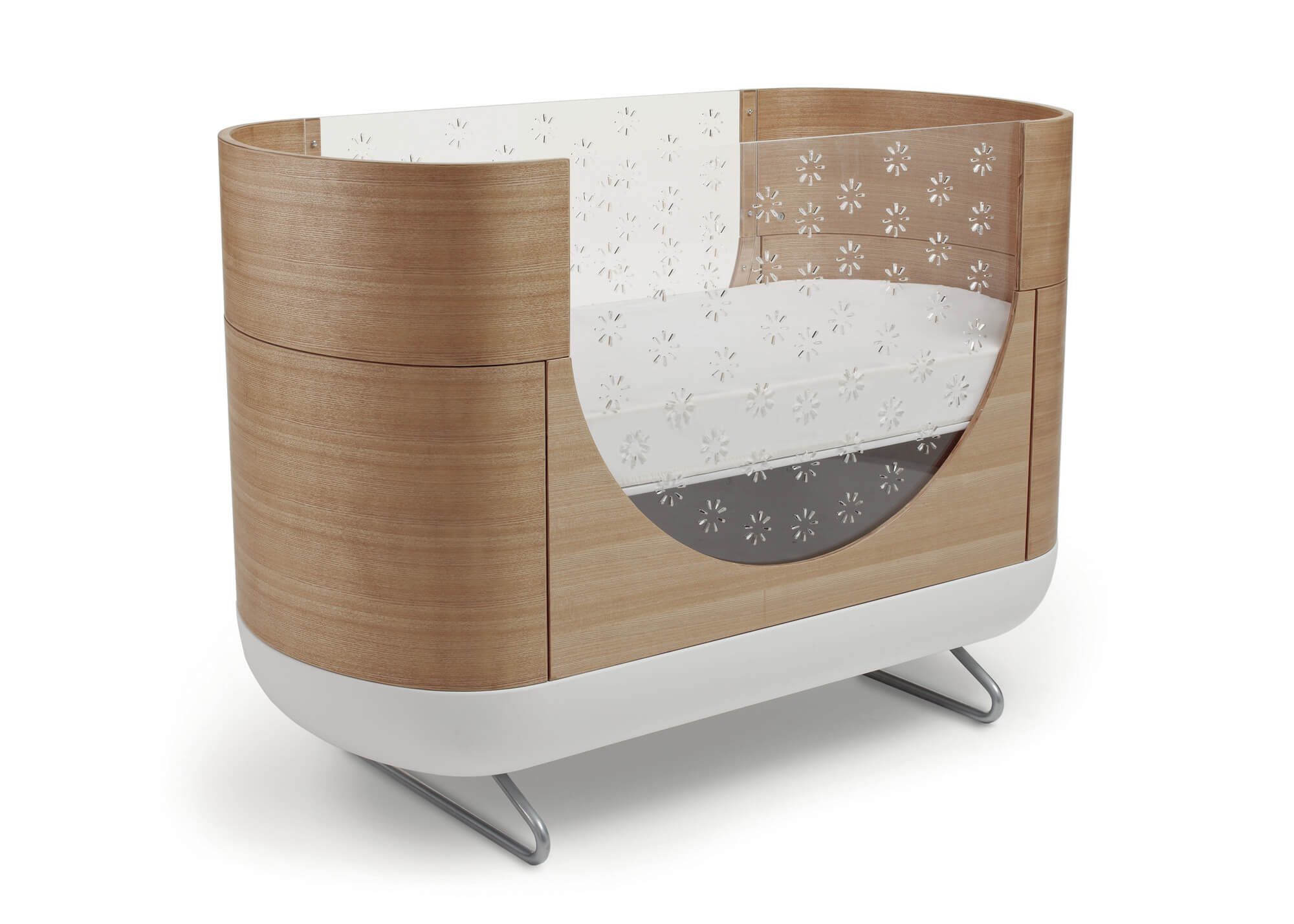 This striking, uniquely designed crib from Ubabub in coccon shape with modernist rounded edges will stand out in any home. Clear side panel has micro laser cuts for airflow, too small for fingers to get into, offering full view of outside world for baby. The smooth, rounded wood construction adds class and elegance in any space.