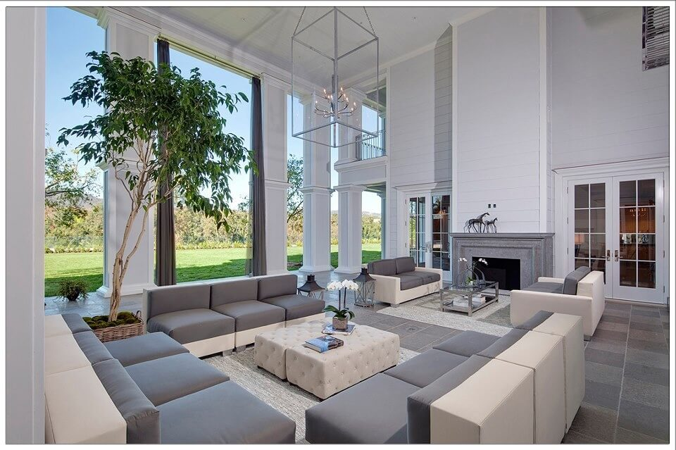 immense two story living room in grey and white tones