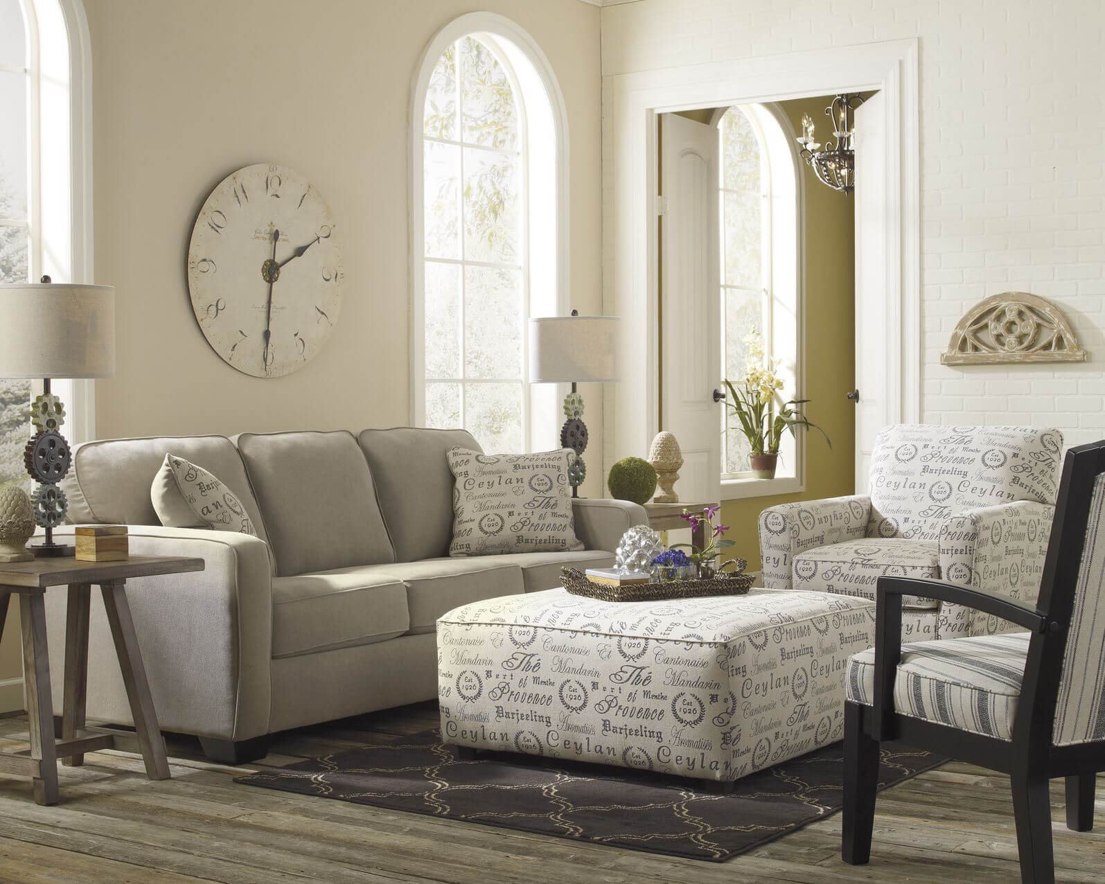 Light Toned Living Room Stands Over Grey Hardwood Flooring